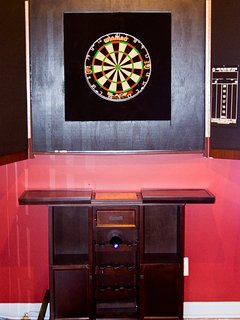 The dart board opened to play