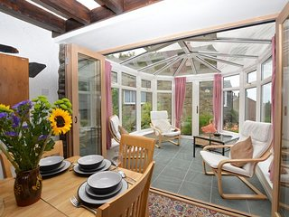 Dining area with doors leading onto conservatory