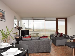 Lounge/kitchen/dining area with sea views