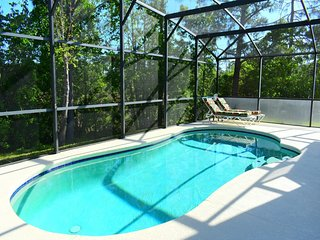 Two story, spacious 4/3 Pool Home at Lake Wilson Preserve. Backed to a