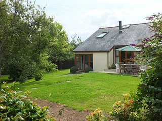 ORCHARD COTTAGE, private and sheltered, in a pretty village near the coast