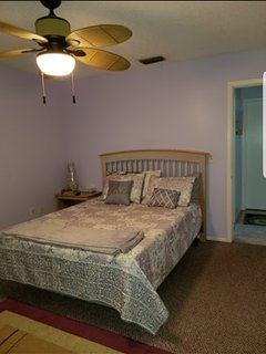 Guest Bedroom with queen and nightstand with dresser and tv