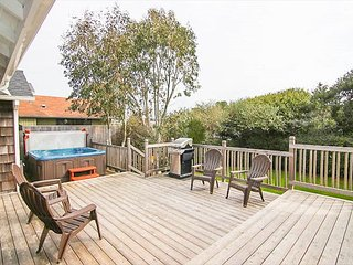 Hot Tub, Fenced Yard One Block from the Beach in this Single-Level Charmer in