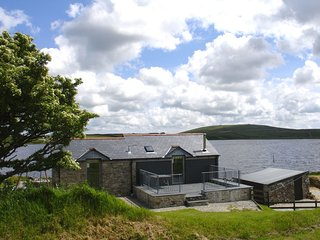 DOZMARY POOL BARN, detached, pet friendly, waterside house with far reaching