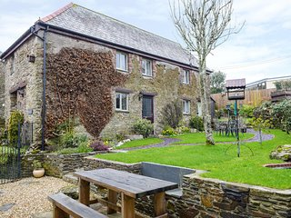 ROWAN COTTAGE, open-plan, shared garden, exposed stonework, in Lanreath
