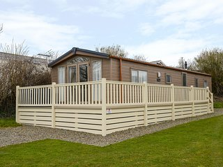 HOLIDAY HOME 5, single-storey lodge on holiday park, two bedrooms, on-site facil