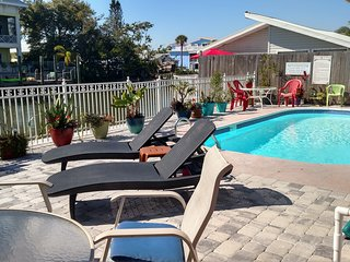 Water front FMB #21, dock, pool, 1 block to beach