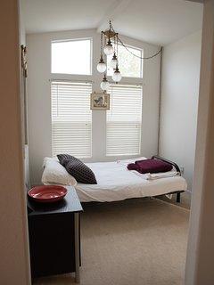 Dogwood queen futon room.