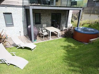 House 32 - This contemporary four level three bedroom detached property located