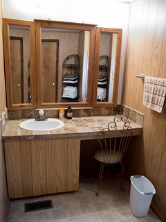 Birch house full bathroom adjoins Cal king room and queen room
