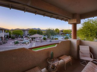 Oro Valley condo with mountain views, shared pool, hot tub, and golf onsite!