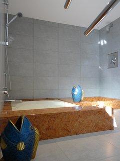 Large family size bathroom, toilet, double sink, sunken bath separate shower.