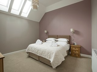 Large superking bedroom with Ensuite bathroom, TV and DVD