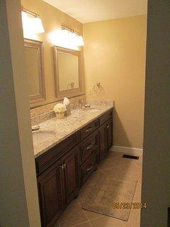 Master bath, 2 sinks, private tub shower, additional closet storage