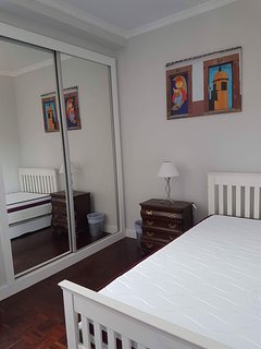 Small bedroom with two single beds