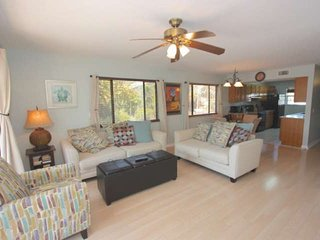 Enjoy a movie on the Flat Screen TV and relax in this Spacious Living Area with Sleeper Sofa