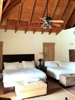 Master bedroom with 2 bed are suitable for 3 guests.