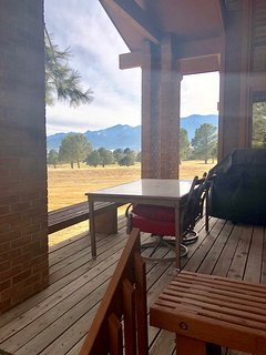 Grill on the side deck with a view of Cheyenne Mountain