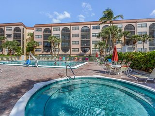 Waterfront living w/ furnished balcony, shared pools, hot tubs, & tennis courts