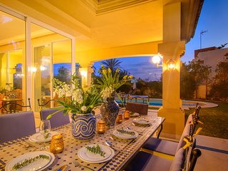 Dining area on terrace with 8 seater dining table