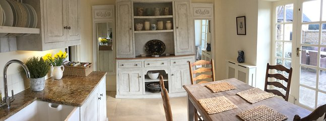 Large dresser in the kitchen. Light and airy and French doors to the sunny courtyard!