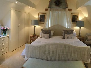 Bedroom 1 . Super king size bed and en-suite bathroom with roll top bath