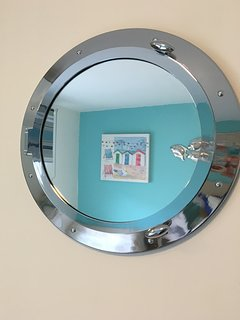 Porthole mirror twin room
