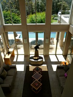 looking from the second floor over the great hall living room and pool
