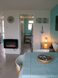 Bunk room, fire and childrens desk for colouring or making things from finds on the beach
