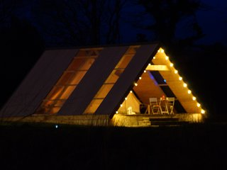Glamping Suite by night is a real delight... patios perfect for star gazing or playing board games..