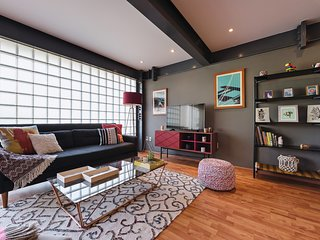 Warm industrial style in two-bedroom Roma Norte stay