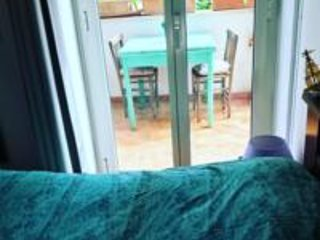 Room with private garden at Penelope's b&b, holiday rental in Prizzi