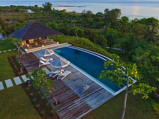 Sunrise over Selalu - a rooftop view over 18 metre fresh water infinity pool, deck and BBQ pavilion.