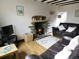 HOPE COTTAGE, woodburner, exposed beams, character, in West Witton