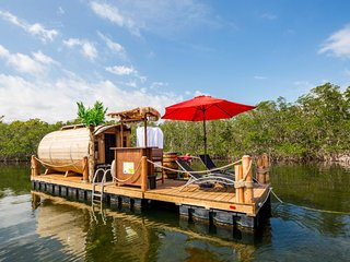 Eco-friendly, waterfront, floating cabin & deck w/ dinghy, tiki bar, & grill