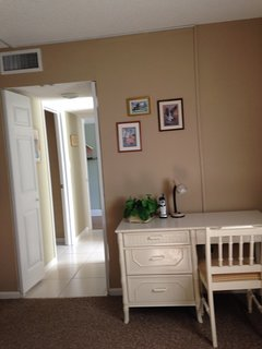 Desk area in Master with adjoining hall to walk in closet and private bath