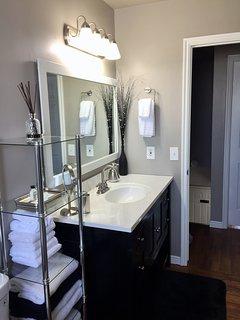 Bright bathroom with plenty of fresh linens.