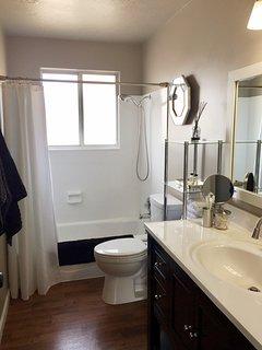 Bathroom has combination shower/tub.