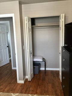 Bedroom #2 has a roomy closet with a luggage rack and extra sheets/blankets.