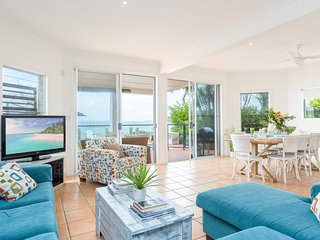 Open plan lounge, dining and kitchen overlooking Moreton Bay and Pool