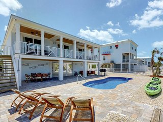 Waterfront home w/ private pool & 60-ft dock near beach, shopping, dining
