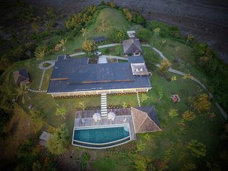 Aerial view of the hilltop retreat w 18m pool, bbq and b'fast pavilions, staff quarters & gardens.