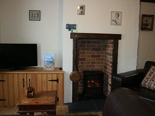 TV with Freeview, free WIFI and Cosy electric log burner.