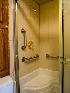 A spot to sit in the shower with grab bars