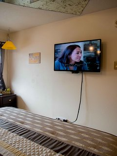 A brand new TV in the bedroom