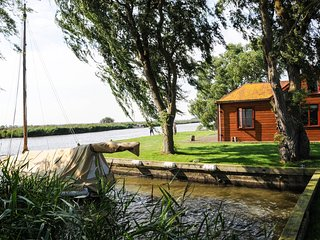 Toad Hall on the banks of Womack Water and the River Thurne