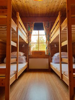 Bedroom 2-Two bunkbeds for 4 people. It has two good size cabinets.