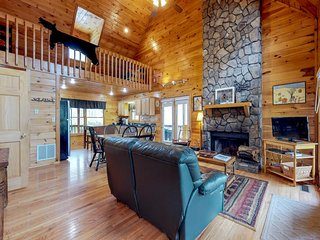 Dog-friendly lakefront cabin w/ private hot tub and paved road access!