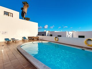Puerto del Carmen, pool and sea views