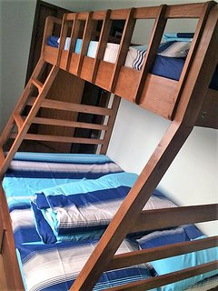 A bunk bed for your family and group.  A spacious bed for your children with windows air conditioner